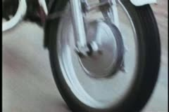 Close-up of motorbike wheel in motion on road - stock footage
