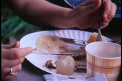 Close-up of girl picking at a plate of food Stock Footage
