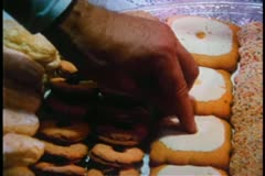 Close-up of male hand touching cookies on tray - stock footage