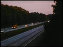 Cars driving on highway at dusk Stock Footage