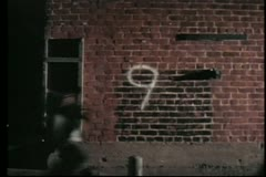 Number countdown from ten to one against brick wall Stock Footage