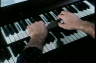 Stock Video Footage of Close-up of man playing an organ