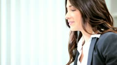 Successful diverse women focus on investment banking  - stock footage