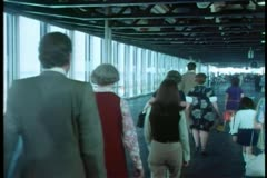 Rear view of people walking in airport Stock Footage