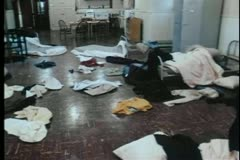 Wide shot of clothing scattered across room Stock Footage
