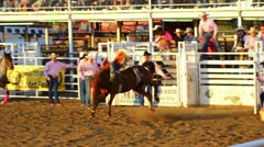 Cowboy rides 8 seconds at rodeo Stock Footage