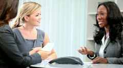Multi ethnic business group working new finance contracts  Stock Footage