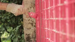 Painting a red gate Stock Footage