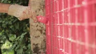 Stock Video Footage of Painting a red gate