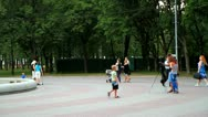 Photographer strolling through the park Stock Footage