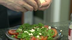 Mozzarella spread over a fresh caprese salad Stock Footage