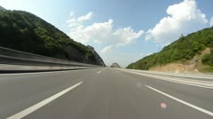 Drive motorcycle on highway Stock Footage