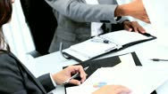 Handshake of ethnic female business manager closing deal with colleagues  Stock Footage