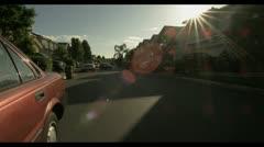 Suburban neighborhood with cars Stock Footage