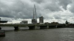 Train on bridge with The Shard London July 7th 2012. Stock Footage