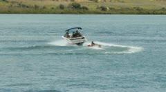 Speedboat tows raft Stock Footage