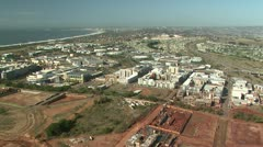 Aerial of building expansion in Durban South Africa Stock Footage
