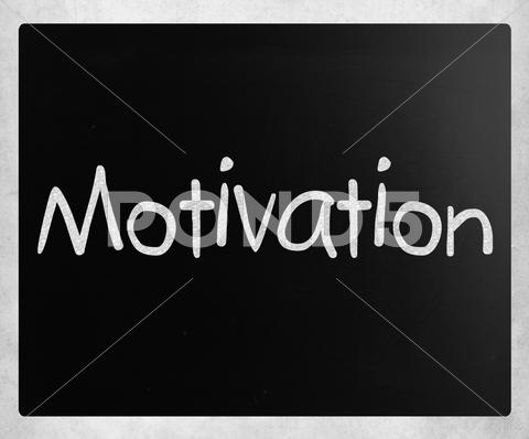 "Stock Illustration of ""motivation"" handwritten with white chalk on a blackboard"