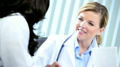 Diverse female doctors communicating scientific research  Stock Footage