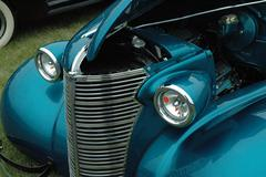 Old car hood and grill shot blue Stock Photos
