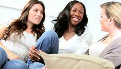 Diverse girlfriends talking and laughing in modern interior   Stock Footage