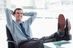 Blissful manager relaxing - stock photo