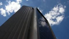 Steel and Glass Building in Clouds - stock footage
