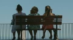 Back of three seated ladies Stock Footage