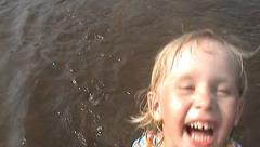 girl laughs in river - stock footage