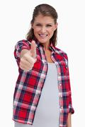 Portrait of a blissful woman with the thumb up - stock photo