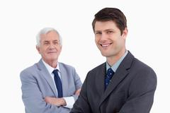 Close up of smiling businessman with his mentor behind him Stock Photos