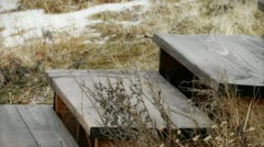 Track shot of old wooden steps in winter - stock footage