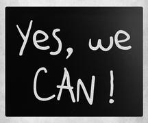 """yes, we can!"" handwritten with white chalk on a blackboard - stock illustration"