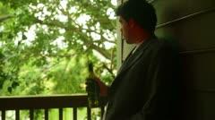 Alcoholic drunk drinking wine unemployed Stock Footage