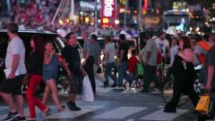 Crowd of people walking crossing street at night in Times Square New York 30p Stock Footage