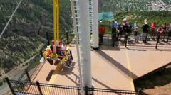 Giant swing that swings out over canyon Stock Footage