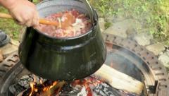 Cooking goulash soup closeup Stock Footage