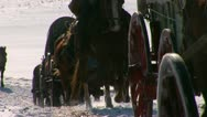 Horses and wagons in being pulled in snow Stock Footage