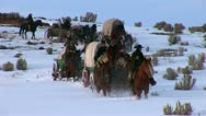 Covered Wagon in winter on western plains Stock Footage