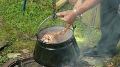 Stirring goulash soup kettle Stock Footage