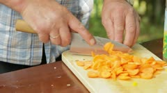 Cutting carrots goulash Stock Footage