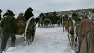 Stock Video Footage of Pulling and pushing handcarts over winter prairie
