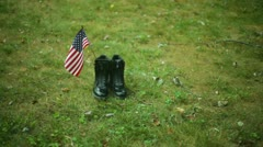 Fallen soldier boots army grave Stock Footage