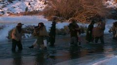 Pioneers crossing freezing river in winter - stock footage