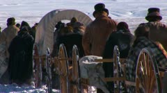 Stock Video Footage of Many people pioneers leaving handcarts to survive