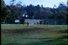 Wide shot of high school football team practicing - stock footage
