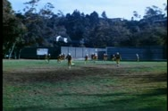 Wide shot of high school football team practicing Stock Footage