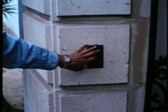 Medium shot of woman ringing door bell Stock Footage