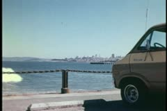 Panning van parked by ocean - stock footage
