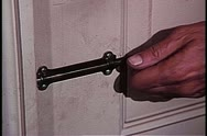 Close-up of man bolting door Stock Footage